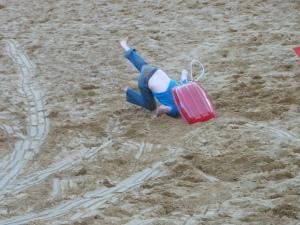 sand dune sledging at Merthyr Mawr